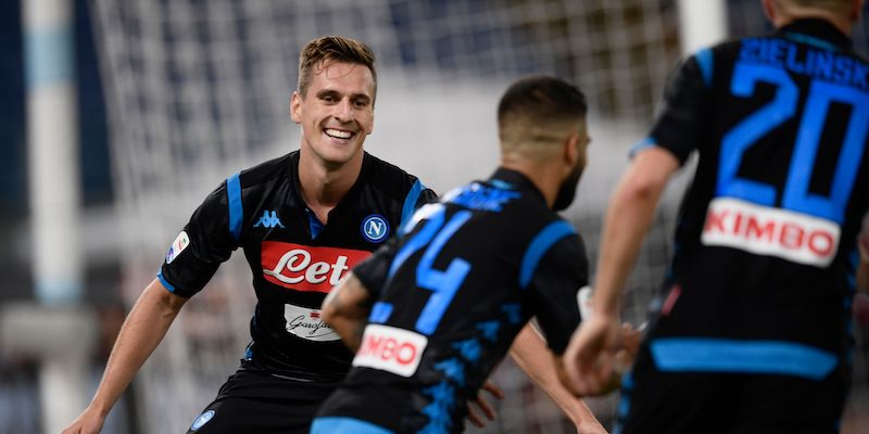Napoli's Polish forward, Arkadiusz Milik (L) reacts after Napoli's forward Lorenzo Insigne (C) scored his team's second goal during the Italian Serie A football match Lazio vs Napoli at the Olympic stadium in Rome on August 18, 2018. (Photo by Filippo MONTEFORTE / AFP)        (Photo credit should read FILIPPO MONTEFORTE/AFP/Getty Images)